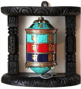 A prayer wheel made with turquoise, coral, and lapis.